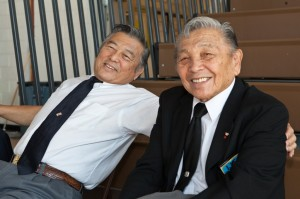 Having worked a lifetime in Judo, brothers Jimmy and Edwin Takemori take a break on the bleachers.