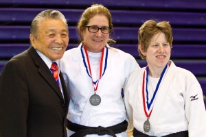 Kata medallists Tamara Hemingway and Cindy Simon congratulated by Sensei Jimmy Takemori