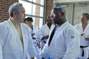 Host Terence McPartland from DC Judo coordinates with Dr Rhadi Ferguson