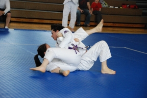Crossing over is part of the fun. Jujitsuka Lori Porsch (BETA) pins Judoka Jenae Michell (DC Judo) in a Judo match.