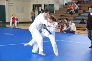 Jennifer Dippel (Jason Morris Baltimore) attempts ouchi-gari on Jenae Michelle (DC Judo)