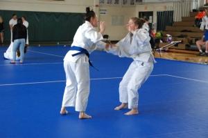 Benedicte Merle (Tohoku Boston) squares off with Anastasia Kouloganes (CPJC)