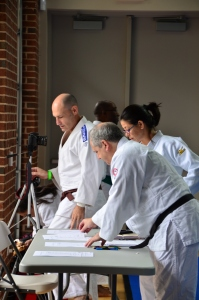 Getting judging and scoring in order. Tournament director Terence McPartland and Shufu Kata Chair Diane Jackson