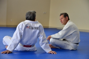 Mary Raby (DC Judo) finds a quiet moment with Edwin Takemori
